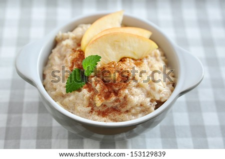 milk rice pudding with apple and cinnamon - stock photo