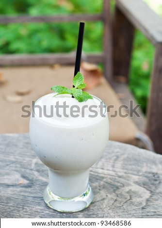 milk shake in the cafe garden - stock photo