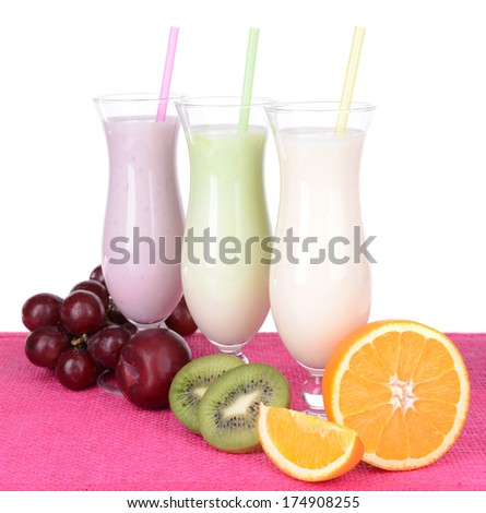 Milk shakes with fruits on table on white background