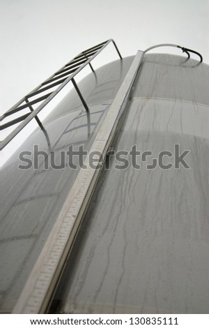 Milk silo on dairy farm, West Coast, South Island, New Zealand. - stock photo