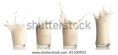 milk splash on a glass on white background - stock photo