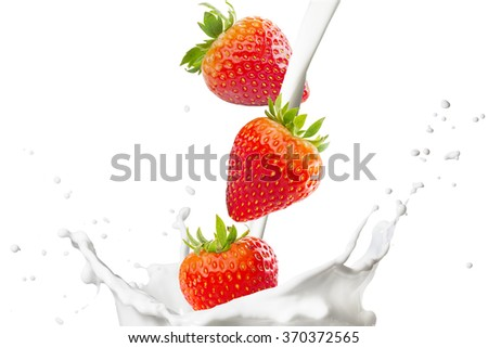 Milk Splash with Strawberries  - stock photo