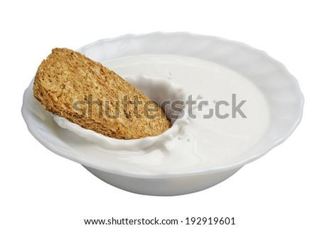 milk splash with wheat biscuit - stock photo
