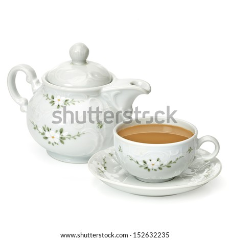 Milk tea in cup with tea pot on white background - stock photo