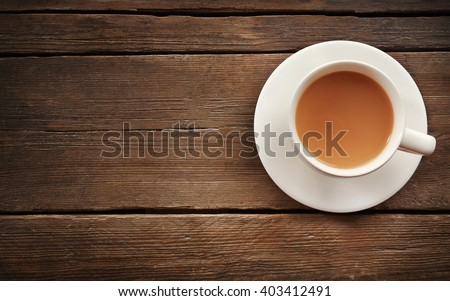 Milk tea on wooden background. - stock photo