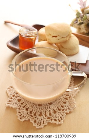 Milk tea with Scotland food scone for gourmet English breakfast image