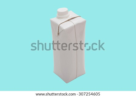 Milk (Water, Juice, Liquid) box shape container in white colour isolated on blue.