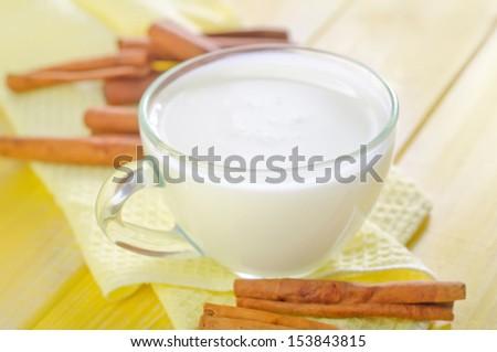 milk with cinnamon - stock photo