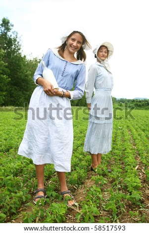Milk woman in a field with a glass bottle of milk in hand