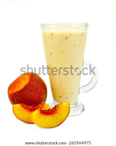 Milkshake in a glass with peaches isolated on white background - stock photo