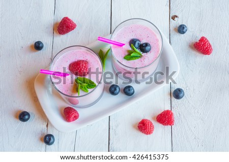 Milkshake with fresh berries: raspberries and blueberries
