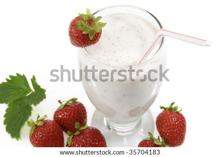Milkshake with fresh strawberries over white background