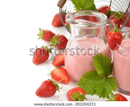 Milkshake with strawberries on a white background - stock photo