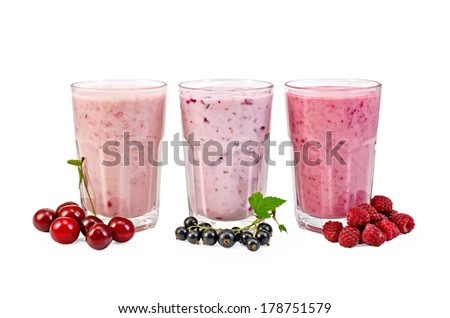 Milkshakes with black currant, cherry, raspberry in glass isolated on white background - stock photo