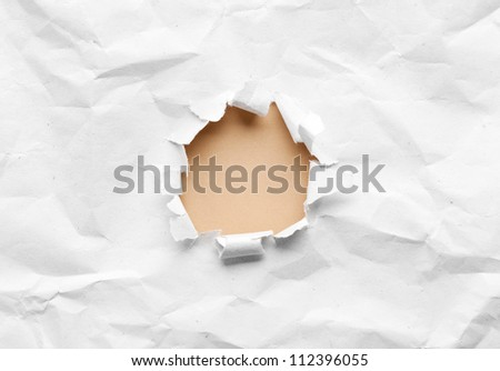 Milky circle shape breakthrough crumpled paper hole with white background - stock photo
