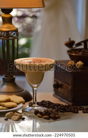 milky coffee cocktail decorated with chocolate chips  - stock photo