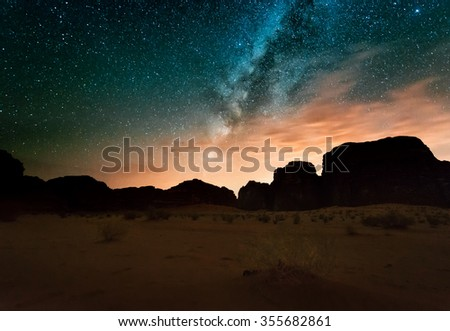 Milky way above red Wadi Rum desert in Jordan.