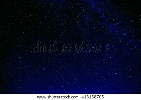 milky way and stars in the night dark blue sky