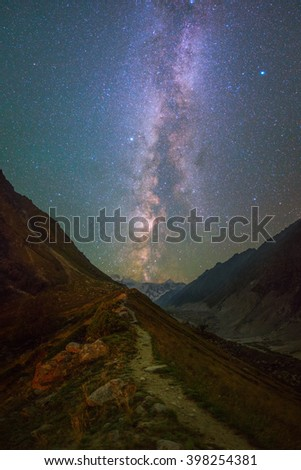 Milky Way and stars over mountains - stock photo