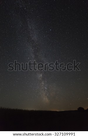 Milky Way Galaxy in the background of the brightest stars of the night sky. - stock photo
