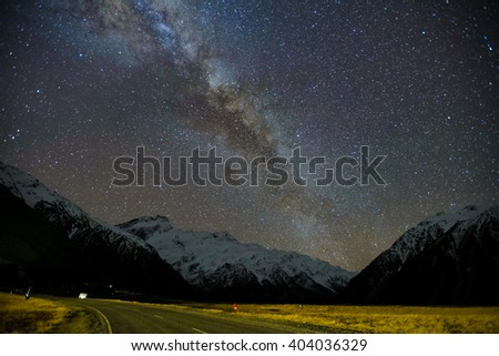 Milky Way Galaxy Rising Above Snow Capped Southern Alps Mountain Range At Mount Cook National Park, Canterbury, New Zealand.  Image Noise Due To High ISO  - stock photo