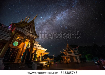 Milky way galaxy with Bright Stars and space dust at wat pa phu kon temple, Udon Thani Thailand   - stock photo