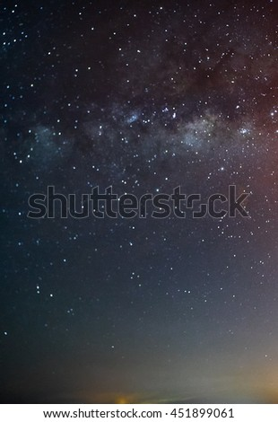Milky way galaxy with stars and clear night sky. Long exposure photograph, with grain.Image contain certain grain or noise and soft focus. - stock photo