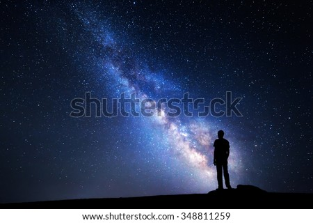 Milky Way. Night sky with stars and silhouette of a man - stock photo