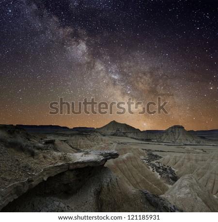 Milky Way over the desert of Bardenas, Spain - stock photo
