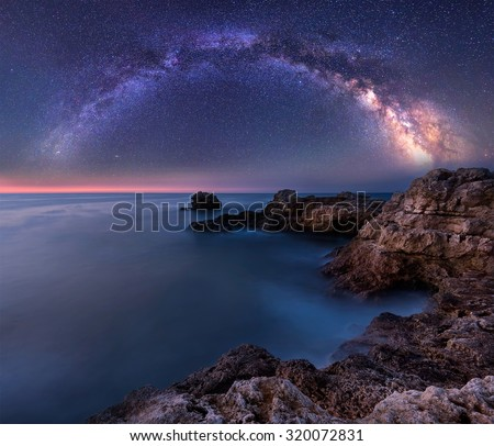 Milky Way over the sea. Long time exposure night landscape with Milky Way Galaxy above the Black sea - stock photo