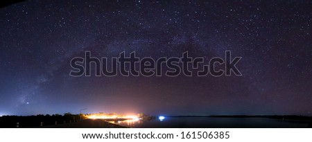 Milky Way rises over the dam inThailand. - stock photo
