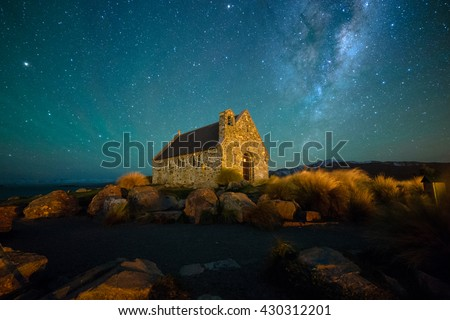 Milky Way Rising Above Church Of Good Shepherd, Tekapo NZ with Aurora Australis Or The Southern Light Lighting Up The Sky . Noise due to high ISO; soft focus / shallow DOF due to wide aperture used. - stock photo