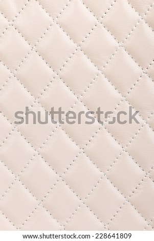 Milky white quilted leather background - stock photo