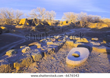 Mill at ancient town of pre-historic Indian cultures of American southwest and surroundings, Aztec Ruins National Monument - stock photo