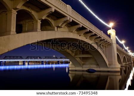 Mill Avenue Bridge across the Salt River in  Tempe Arizona photographed at sunset. - stock photo