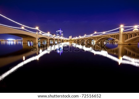Mill Avenue Bridges in Tempe Arizona with historic Hayden Mill in the background. - stock photo