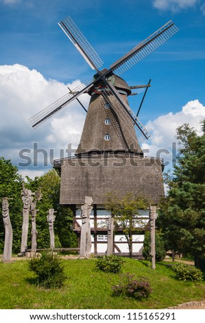 Mill in summer day against the sky