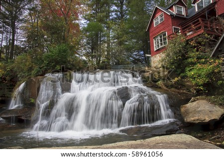 Mill Shoals Falls with old red mill house in North Carolina