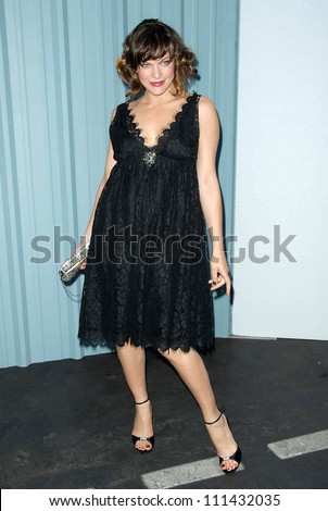Milla Jovovich at the 2007/2008 Chanel Cruise Show Presented by Karl Lagerfeld. Hanger 8, Santa Monica, CA. 05-18-07 - stock photo