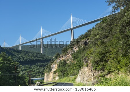 MILLAU, FRANCE - JULY 6, 2013: The famous Millau Bridge, modern highway built over the Tarn Valley, near the city of Millau on July 6, 2013. Inaugurated in 2004. It is the highest bridge in the world.