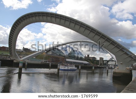 Millenium Bridge is a spectacular addition to the already famous roll-call of bridges across the River Tyne. It cost 22 million to build and it opens to let boats pass under - stock photo