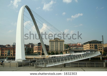 Millenium Bridge is a spectacular addition to the already famous roll-call of bridges across the River Tyne. It cost 22 million to build and weighs over 850 tonnes. - stock photo