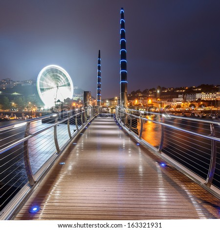 Millennium Bridge and Observation Wheel at dusk Torquay Devon England UK Europe - stock photo