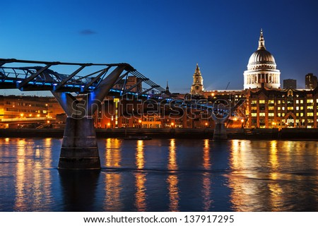 Millennium bridge and St Paul cathedral at dusk. - stock photo