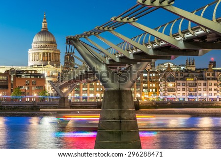 Millennium Bridge and St Paul Cathedral at dusk. Wonderful London summer skyline. - stock photo