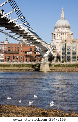 Millennium Bridge and St. Paul's Cathedral - stock photo