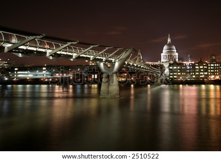 Millennium Bridge and St. Paul's Cathedral in London, UK. - stock photo