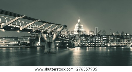 Millennium Bridge and St Pauls Cathedral at night in London - stock photo