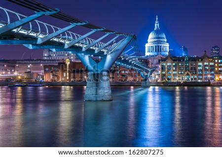 Millennium Bridge leading to Saint Paul's Cathedral in central London, UK. Aged photo.  - stock photo