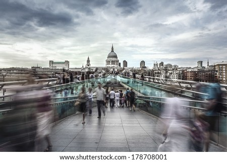 Millennium Bridge leads to Saint Paul's Cathedral in central London  - stock photo
